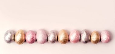 Colored chicken and quail eggs of pink, silver, golden, purple color