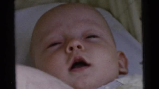 babies lying in crib