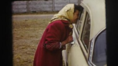 woman in headscarf talking