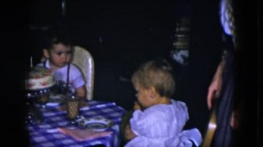 kids sitting at festive table