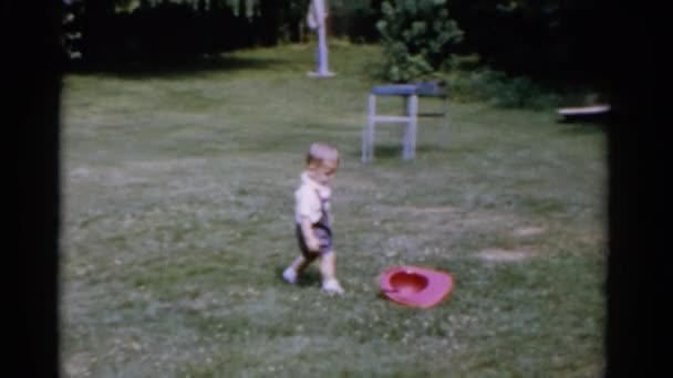 boy playing with plastic cap