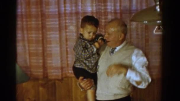 granddad holding little boy
