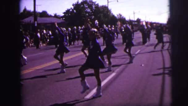 girls twirling batons while marching in a parade