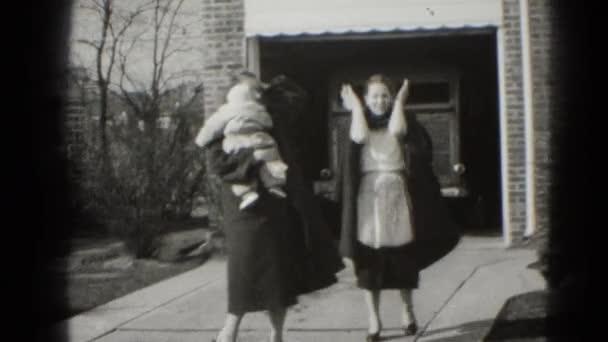 Two women walking towards camera