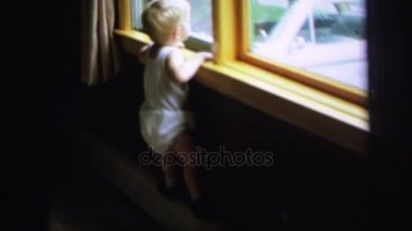 Child looking at window