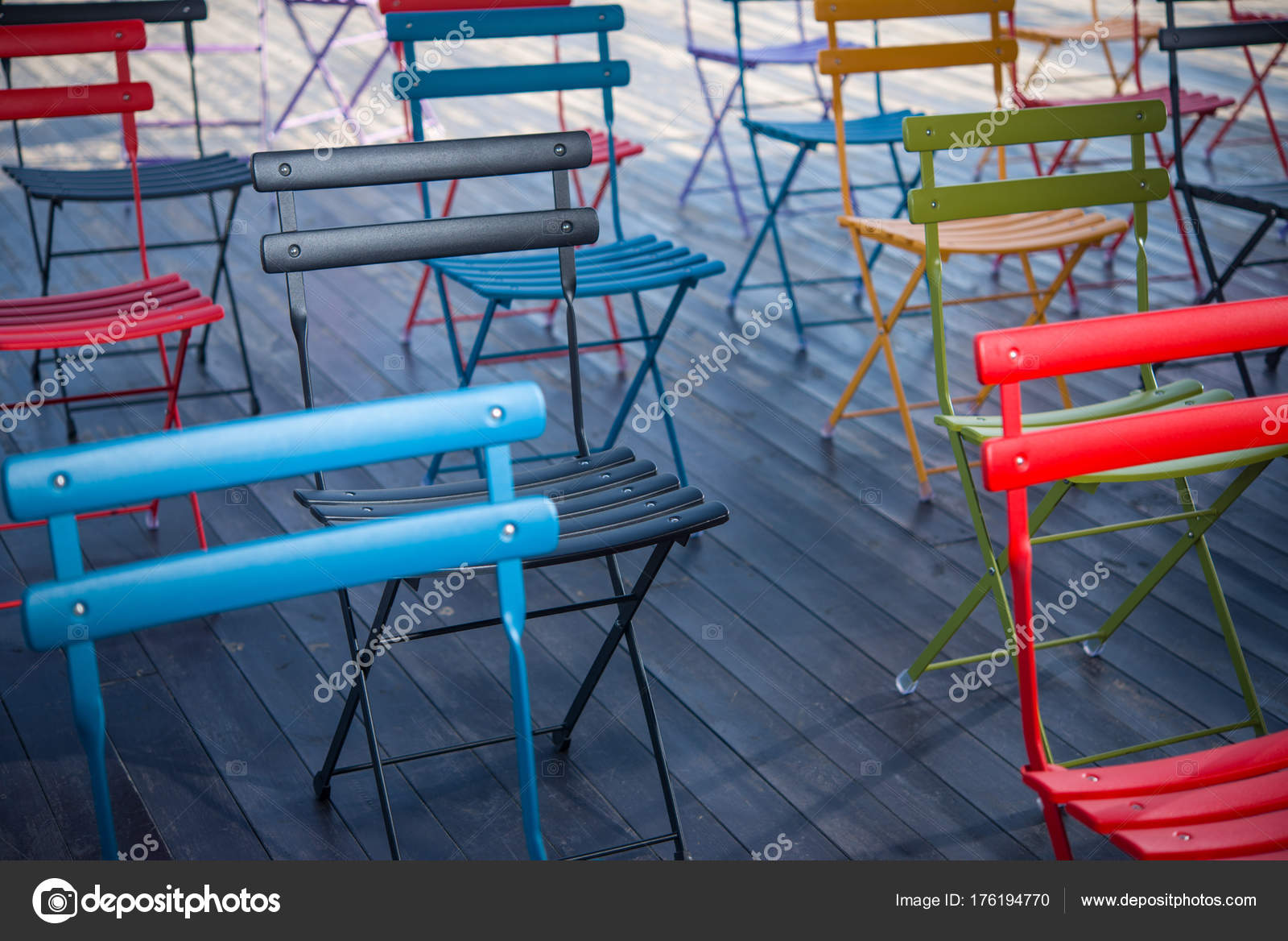 Colored Folding Chairs For A Seminar Or Training On An Open Wooden Terrace  U2014 Photo By Absurdov