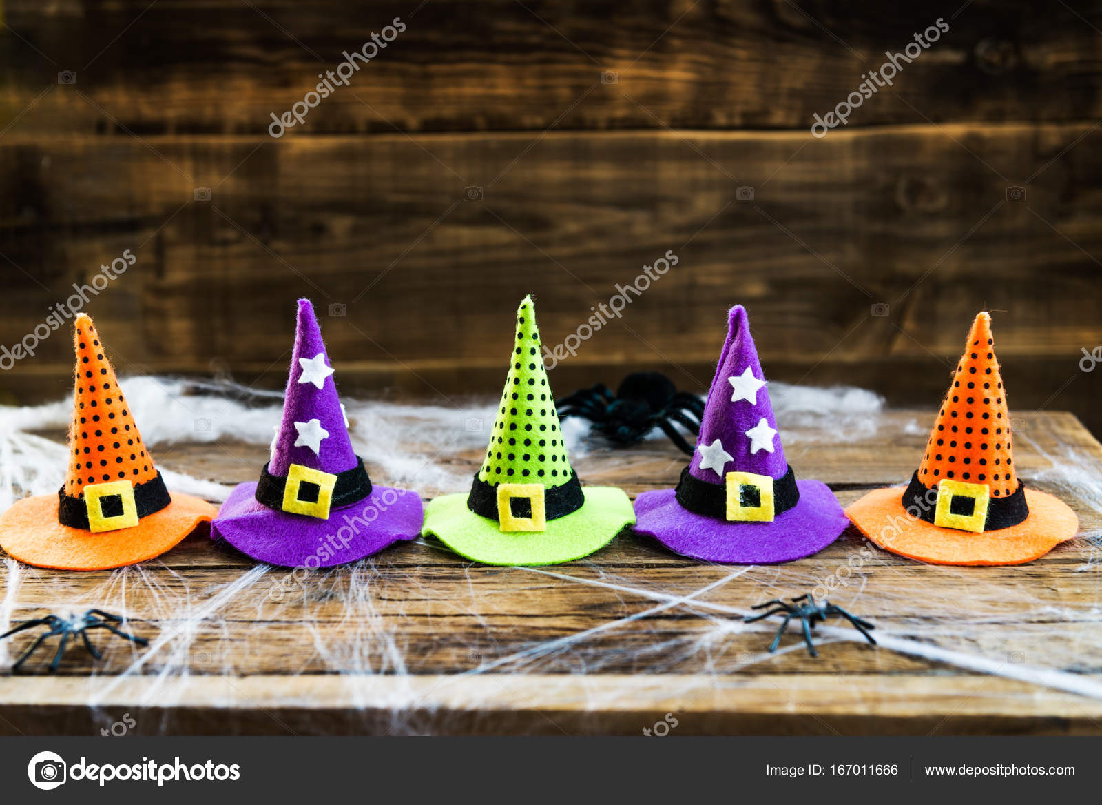 da0bc8f28e0 Halloween card concept with cute little witch hats on spider web ...