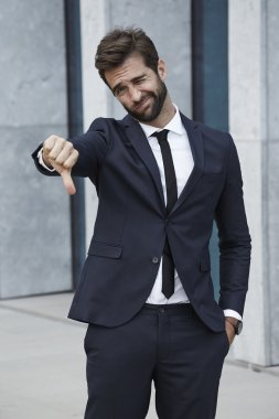 Handsome Businessman with thumb down