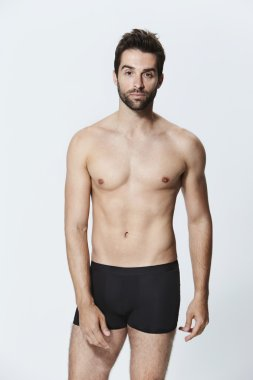 Handsome man in black underwear