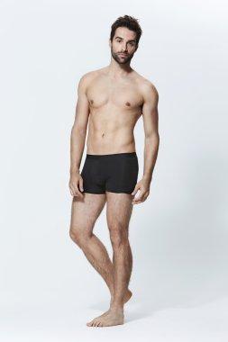 Handsome man in black underwear