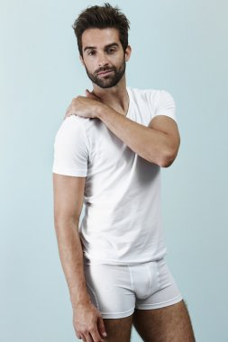 Man in white t-shirt and shorts