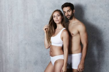 Couple posing in underwear