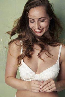 Brunette woman in white bra
