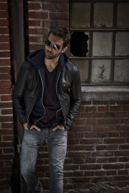 Man in jeans and leather jacket