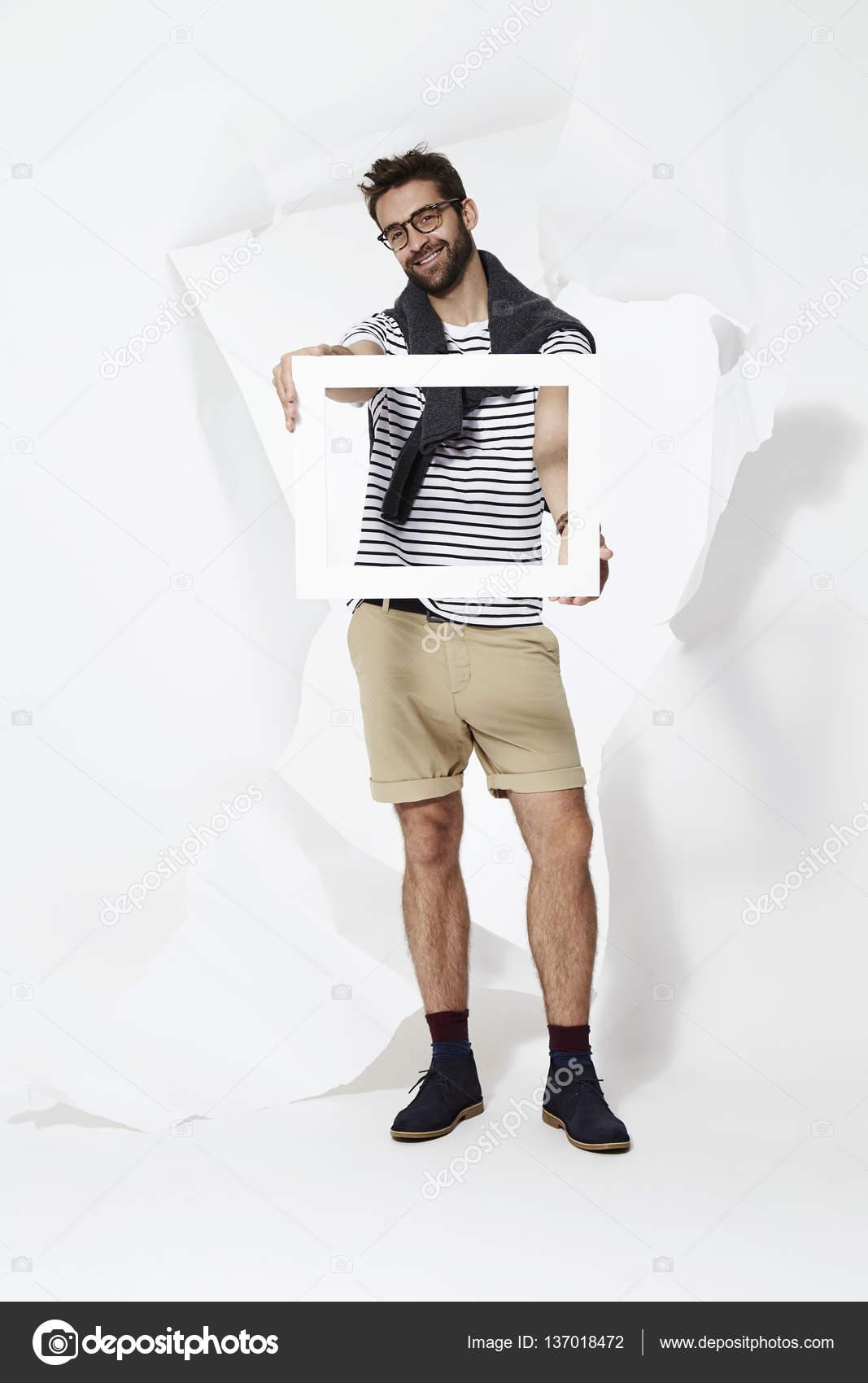 Man holding frame — Stock Photo © sanneberg #137018472