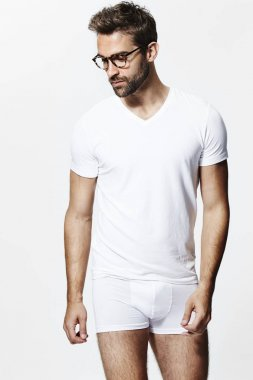Man in glasses and white t-shirt