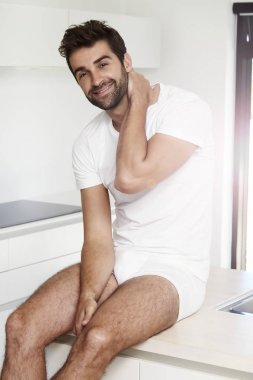 Bearded man in white underwear