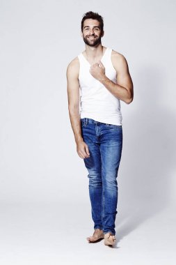 Barefoot man in vest and jeans