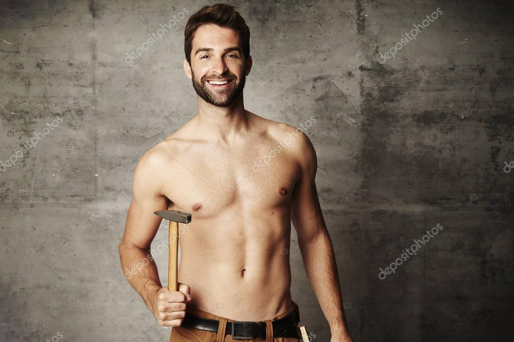 Shirtless man with hammer