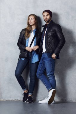 Cool couple in leather jackets and jeans, portrait stock vector