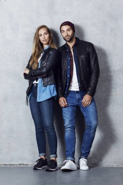 Beautiful couple in denim pants and leather jackets, portrait stock vector