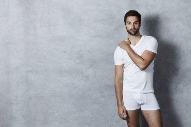 Handsome man in white underwear