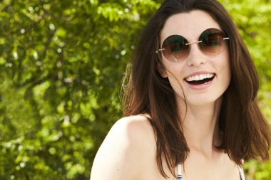 woman laughing in sunglasses