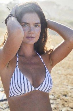 bikini babe posing in sun