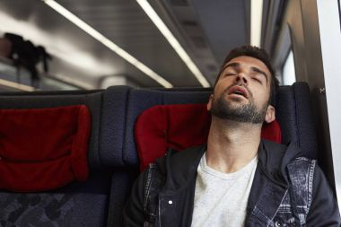 Sleeping passenger on train