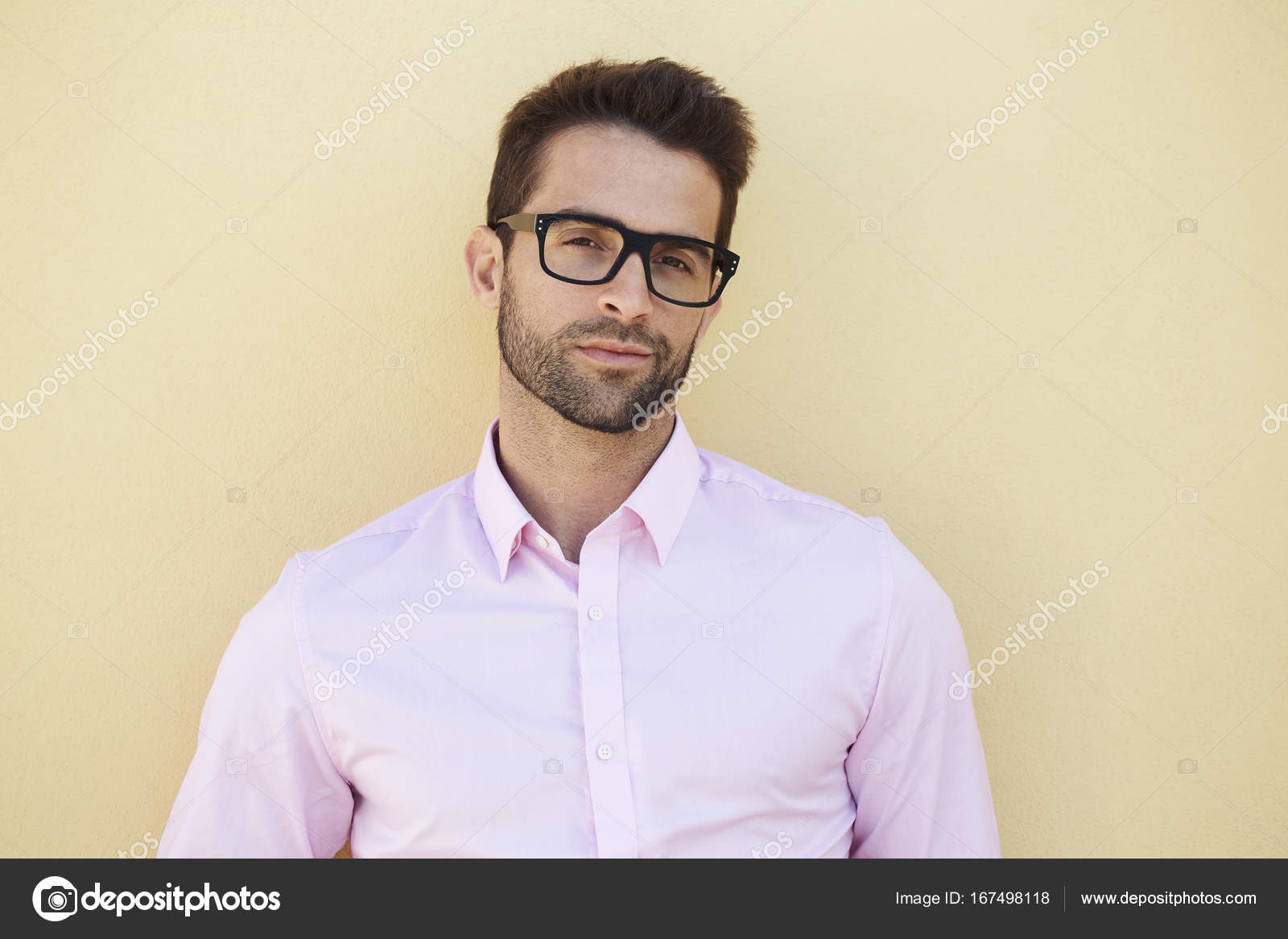 bb6f7e0cac8 Close up of good looking guy in glasses and pink shirt — Photo by ...