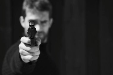 Guy with gun aiming at camera