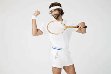 Tennis player flexing muscle
