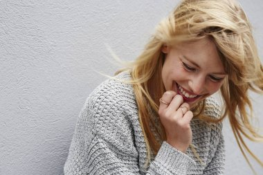 laughing young blond woman