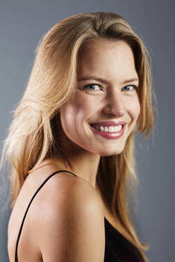 Portrait of blond young woman smiling at camera