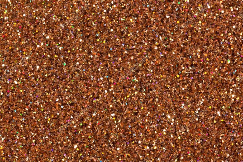 Light brown glitter background.