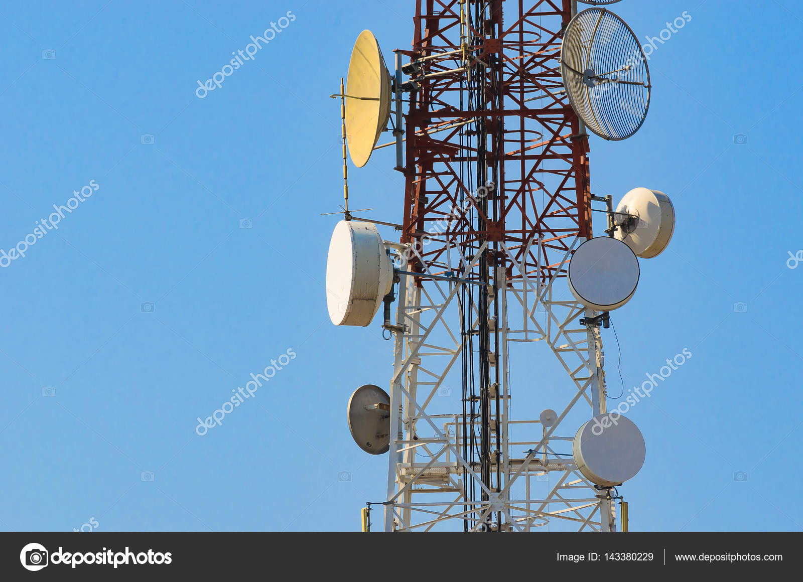 Mobile phone communication antenna tower with satellite dish