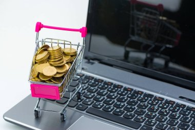 Shopping cart or supermarket trolley with laptop notebook on whi