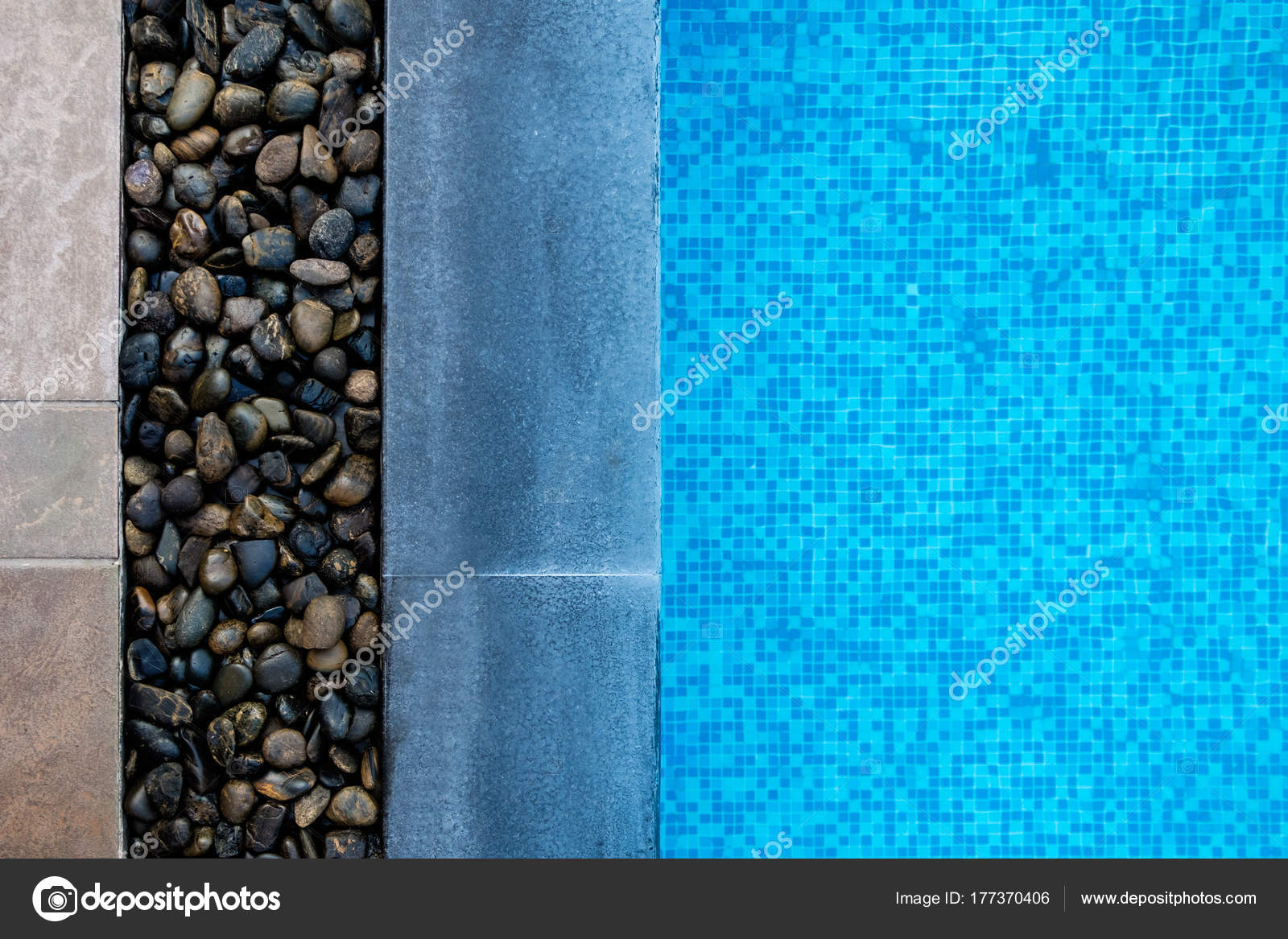 Edge of swimming pool with blue mosaic tiles at the bottom ...