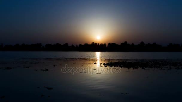 sunrise on the lake, sunrise over river, motorboat at sunrise, morning Landscape, timelapse of sunrise at the river with water lily, 4K timelapse of sunrise over lake