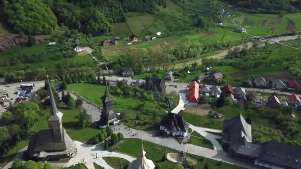 Aerial view of Sapanta-Peri Monastery, Bucovina  Romania, Wooden church UNESCO world heritage site, Religious symbol, Old wooden church and the gardens