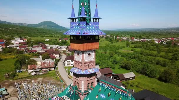Aerial view of  Church in Merry Cemetery, Colored Tombstones with Spiritual and Merry Cemetery in Maramures, Romania, Decorated tombstones in the Merry Cemetery