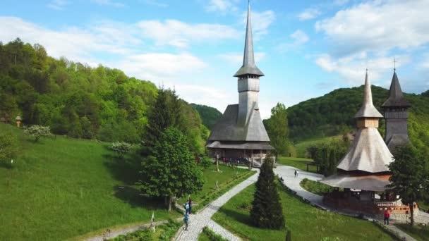 Aerial view of Sapanta-Peri Monastery, Bucovina  Romania, Wooden church UNESCO world heritage site, View of the old wooden Church in the fog, Religious symbol, Old wooden church and the gardens