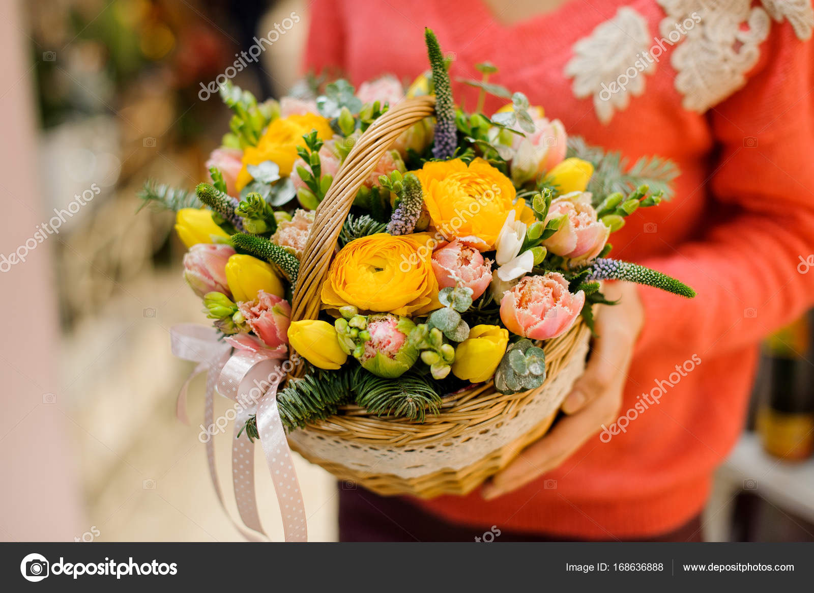 Little Pretty Wicker Basket With Winter Flower Composition Stock