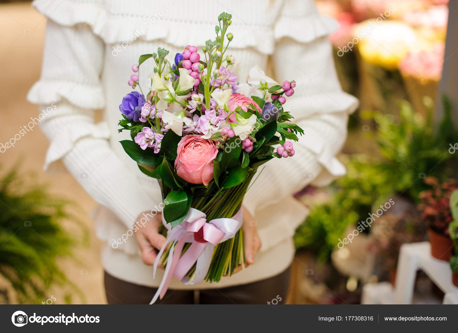 Woman dressed in a white sweater holding a pretty flower bouquet for woman dressed in a white sweater holding a pretty flower bouquet for valentines day stock izmirmasajfo