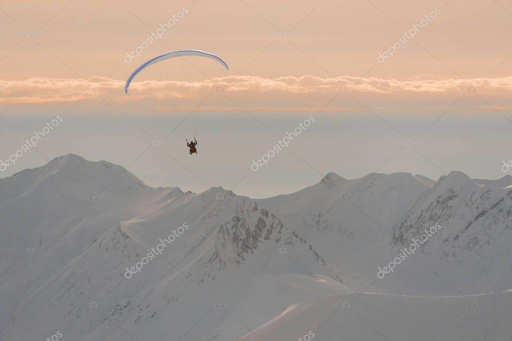 Man flying on the parachute in Gudauri, Georgia
