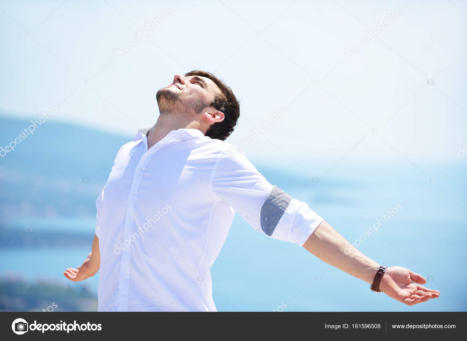 young man with outstretched arms stock photo blicsejo 161596508