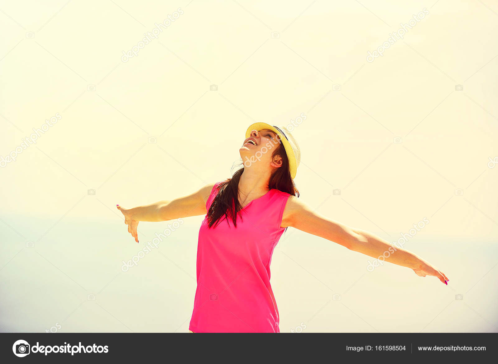 young woman with outstretched arms stock photo blicsejo 161598504