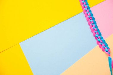 A bookmark in the book separates pink and blue colors. Fashion design of pastel abstract background