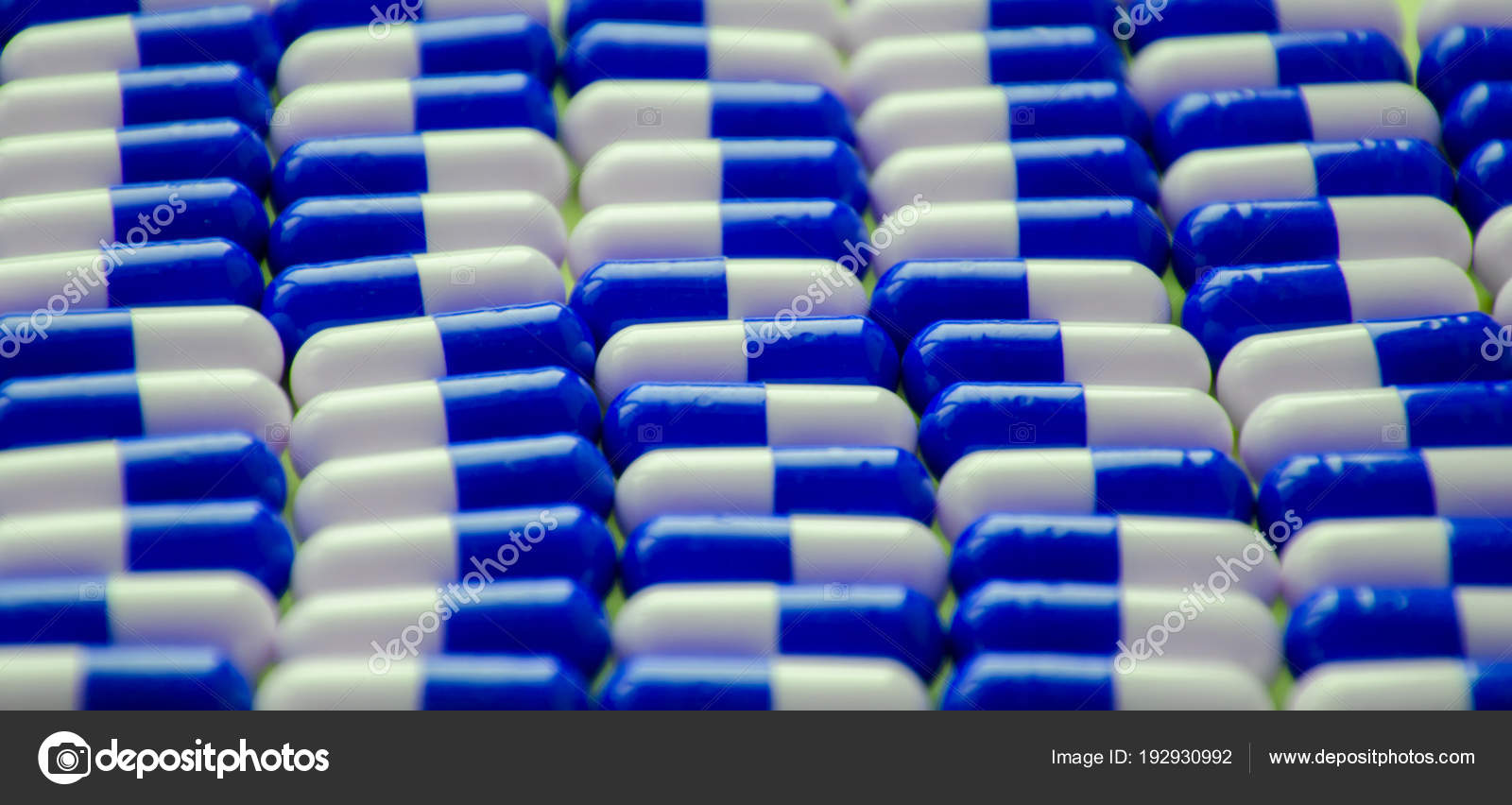 Red White Pills Capsules Lies Rows Blue Background Close