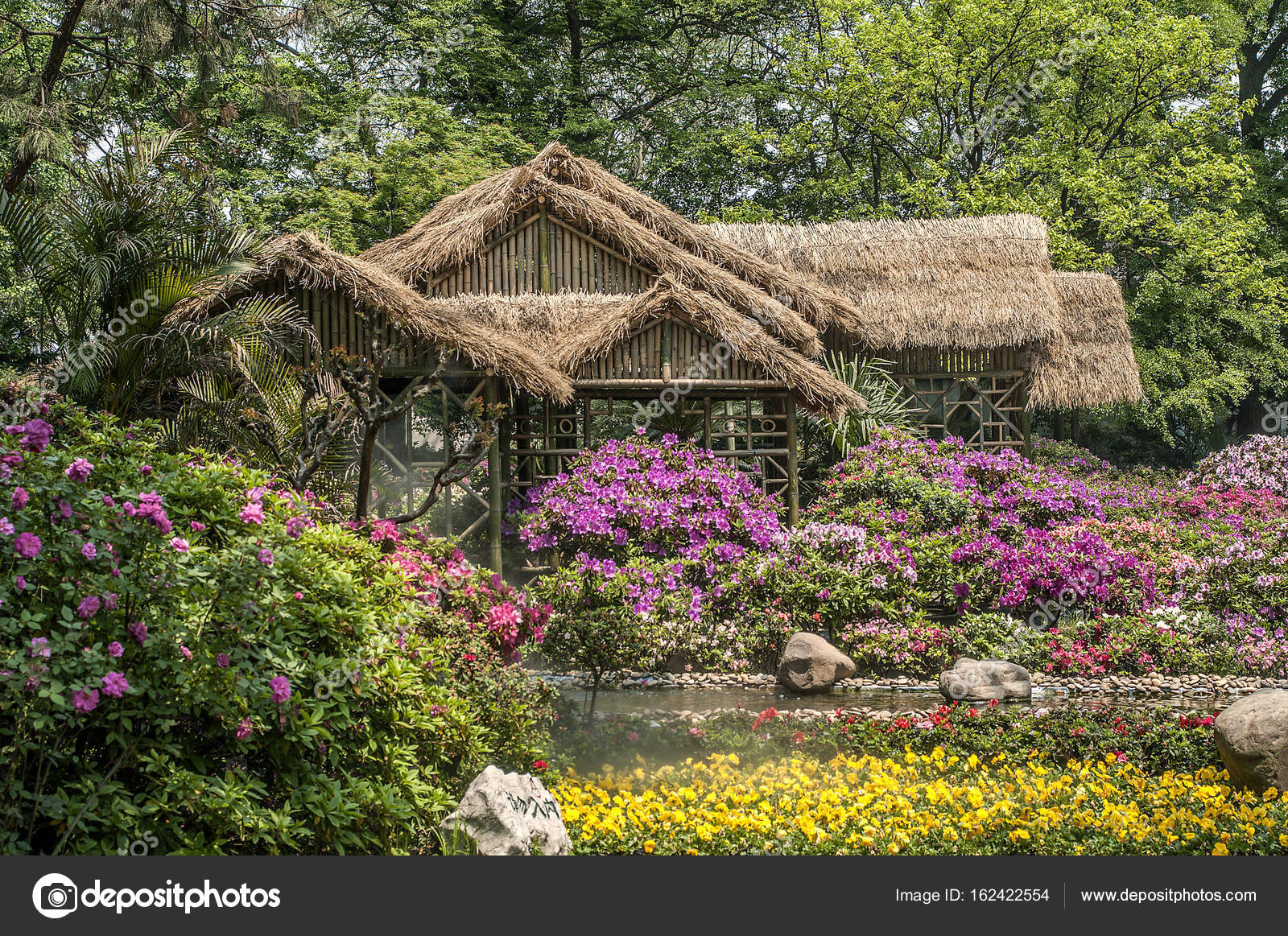 Man Made Chinese Landscaped Gardens   A Poem Of Flowers, Stones U2014 Stock  Photo
